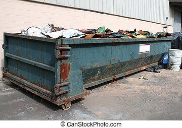 Old dumpster - Smashed barrels in a old dumpster