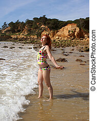 freedom 2 - woman soaks up the sun at the beach in the...