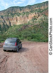 Dirt Road - A dirt road going through the mountains in...