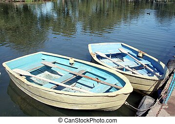 Wooden Row Boats - Two docked wooded row boats