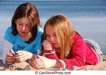 Girl friends talking - Girlfriends talking on a beach