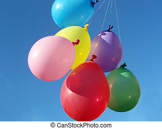 colored balloons - Many colored balloons against blue sky