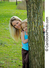 Mother and Daughter3 - peeking from behind the tree