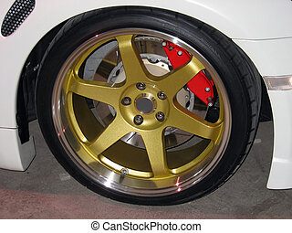 gold rims - custom gold rims on a white sportscar complete...