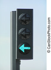 Green traffic light with blue sky as background