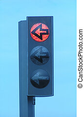 Red traffic light with clear blue sky as background