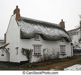 English Thatched Cottage - Quaint rural house dusted with...