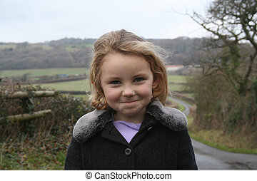 Cheeky looking girl on country walk - Cheeky looking young...