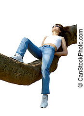 Happy girl relaxing outdoors on tree branch isolated - Happy...