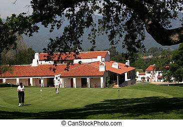 Country Club Golf - A couple plays golf at a course in...