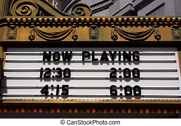 Now Playing - A retro style theater marquee with show times.