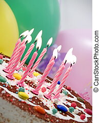 birthday candles - Eleven burning candles at birthday cake,...