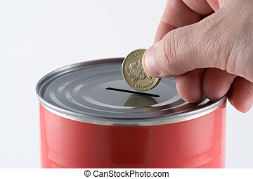 Save your money - Putting a coin into a savings tin
