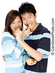 Food Fun - A young couple feeding each other chips