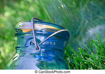 Glass Canning Jar - Blue glass jar with a wire holding the...