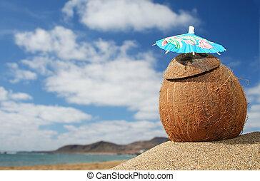 Beach Cocktail - Coconut cocktail on tropical beach