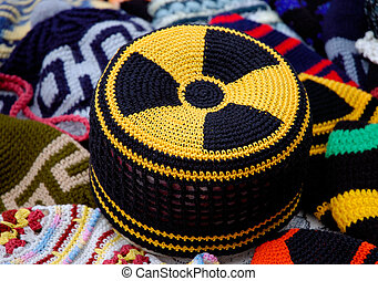 Nuclear radiation hazard sign on knitted hat - Nuclear...