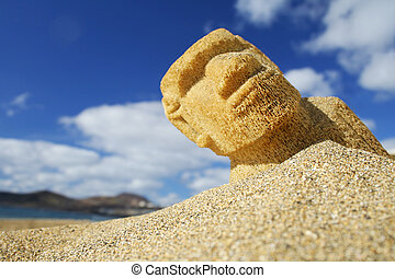 Beach Sculpture - Easter Island Moai half buried in the sand