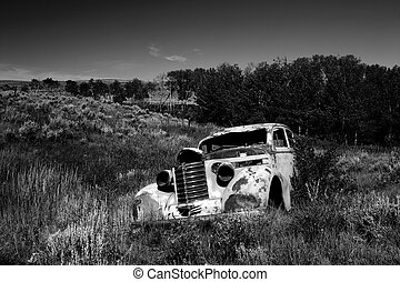 An abandoned 1930's car in a field in Montana - A 1930\\\'s...