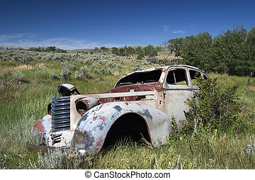 An abandoned 1930s car in a field in Montana - A 1930s style...