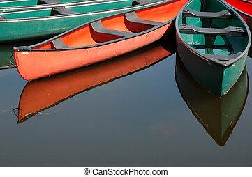 Canoes at Dows Lake in Ottawa - Rental canoes tied up at...