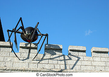 giant spider on a castle roof