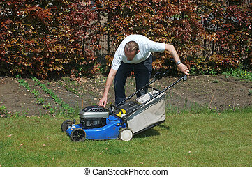 Gardening - Handsome Middle aged man working in the garden...