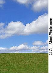 Grass and Sky - Grass hillside against a blue sky with alto...