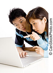 Pointing - A young asian woman points at the laptop screen