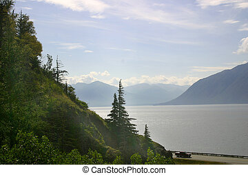 Misty Bay - Mountains appear out of mist across Turnagain...