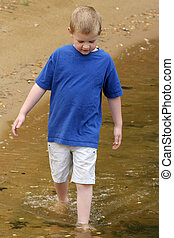 Wading - A child wading in a lake.