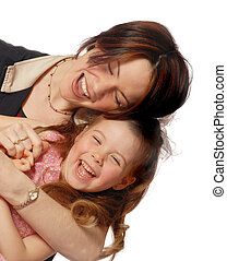 Laughing - happy mother and daughter