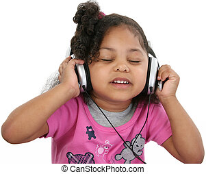 Music - Beautiful 3 year old girl listening to headphones.