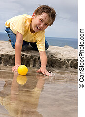 Happily Playing - Happy child playing and splashing with...