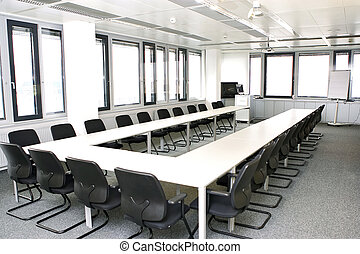 table- u - Chairs and table in a conference room