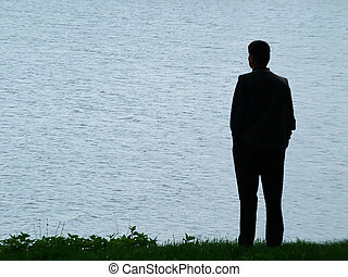 Man silhouette at evening - Man silhouette at lakeside