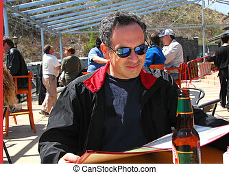 Man restaurant patio - Man sitting on a restaurant patio...