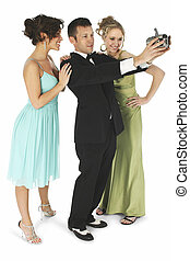 Say Cheese - Handsome man in tuxedo with two beautiful young...