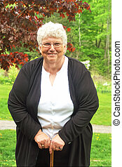 granny - grandma using her cane to wolk
