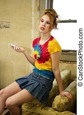 Digital Music - Beautiful Hispanic teen girl in impoverished...