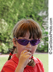child with blue sunglasses