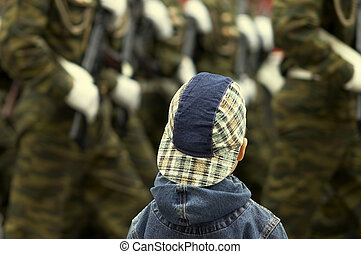 boy and military on the parade