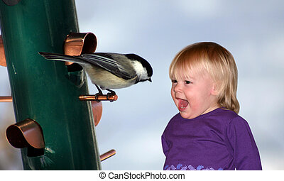 Hi Birdie! - a little girl talking to a chickadee