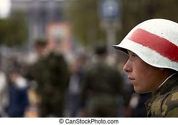 young soldier in white helmet