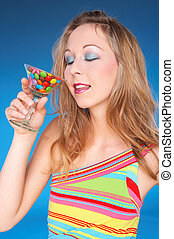 liquid sweets - girl in summerdress having a candy drink