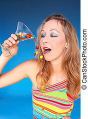 sweet fluid - girl in summerdress drinking a glass full of...