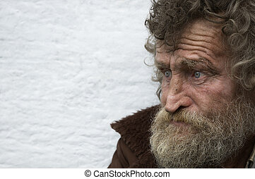 homeless man - hobo in close up with empty space for text
