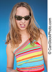 naughty look - girl in summerdress with dark sunglasses