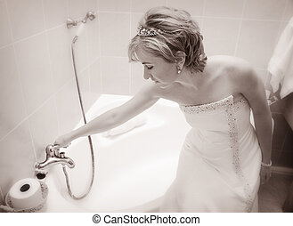 Bride preparing a bath - Young Bride sitting on the bath tub...