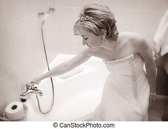 Bride preparing a bath - Young Bride sitting on the bath tub...